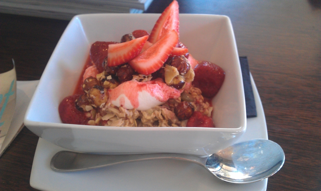 Apple Bircher muesli w/ vanilla poached strawberries, honey yoghurt & toasted hazelnuts