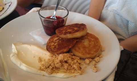 Housemade crumpets, berry compote, peanut gravel & double cream ($13.50)