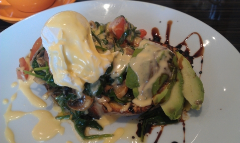 Provincial poached egg, spinach, tomato, mushrooms, avocado, hollandaise on toast