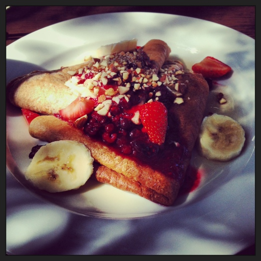 Pancakes topped with banana and berries